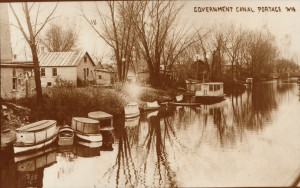 Canal Scene with Small Boats and Houses